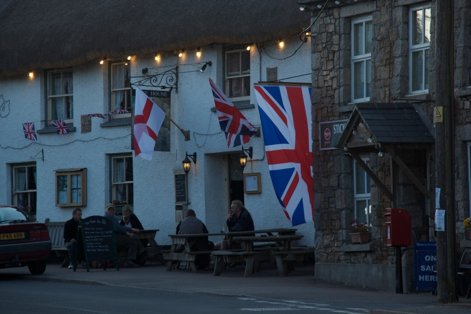 Taw River Inn with flags, Sticklepath, Devon