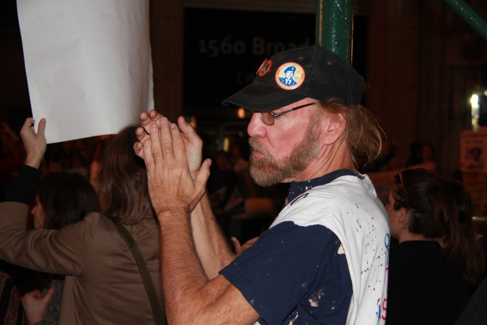 Man clapping 46th st Times Sq protest