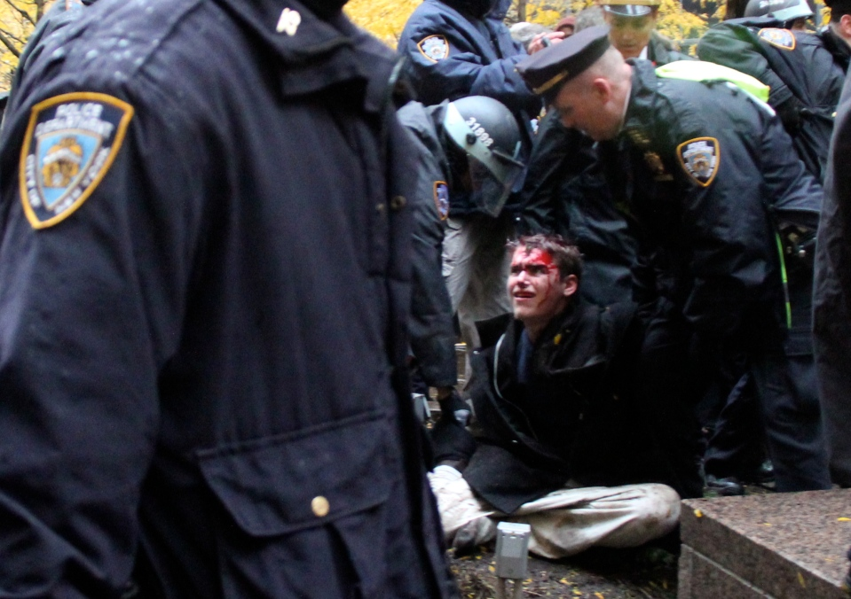 Injured protestor with police Zuccotti Park OWS