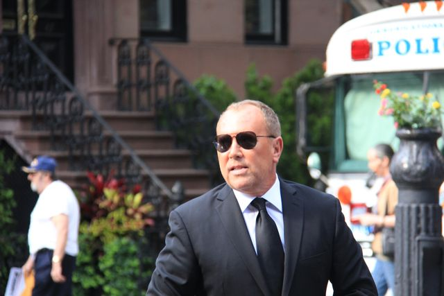 Michael Kors wearing dark suit and sunglasses at Obama fundraiser in New York