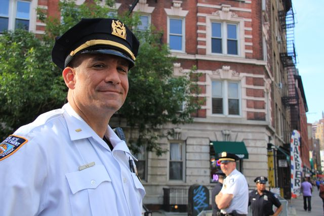 Smiling NYPD cop in white shirt