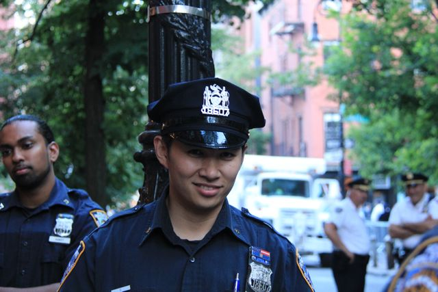 Cute NYPD cop grinning in NYC street