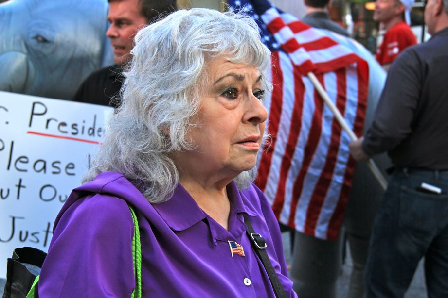 Older American Woman with stars and stripes in New York City