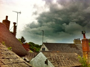 Jumble roofs and dark clouds