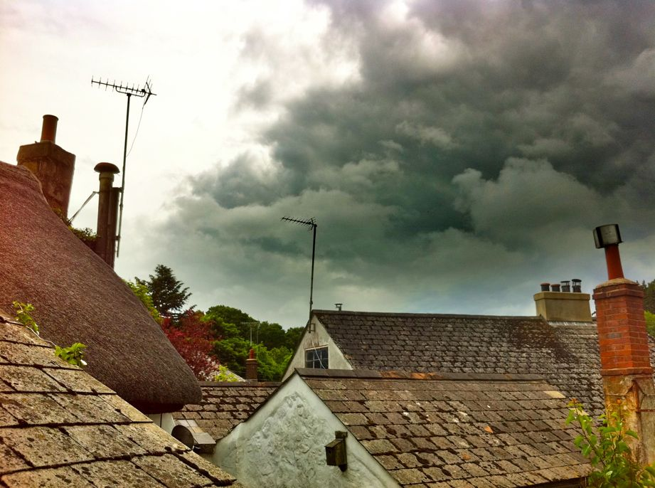 dark cloud, tiles and thatch