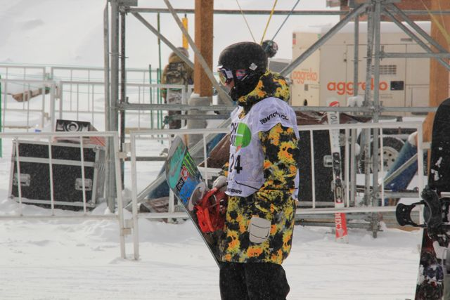 Dew Tour competitor with board standing in snow