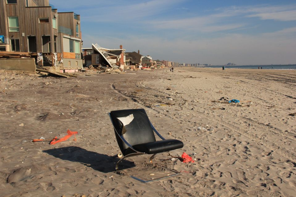 Mid-century black chair on beach