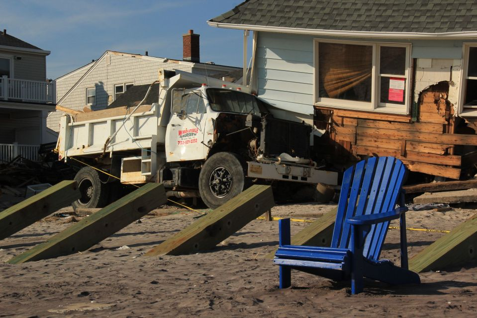 Dump truck with crashed house Rockaway Beach blue chair