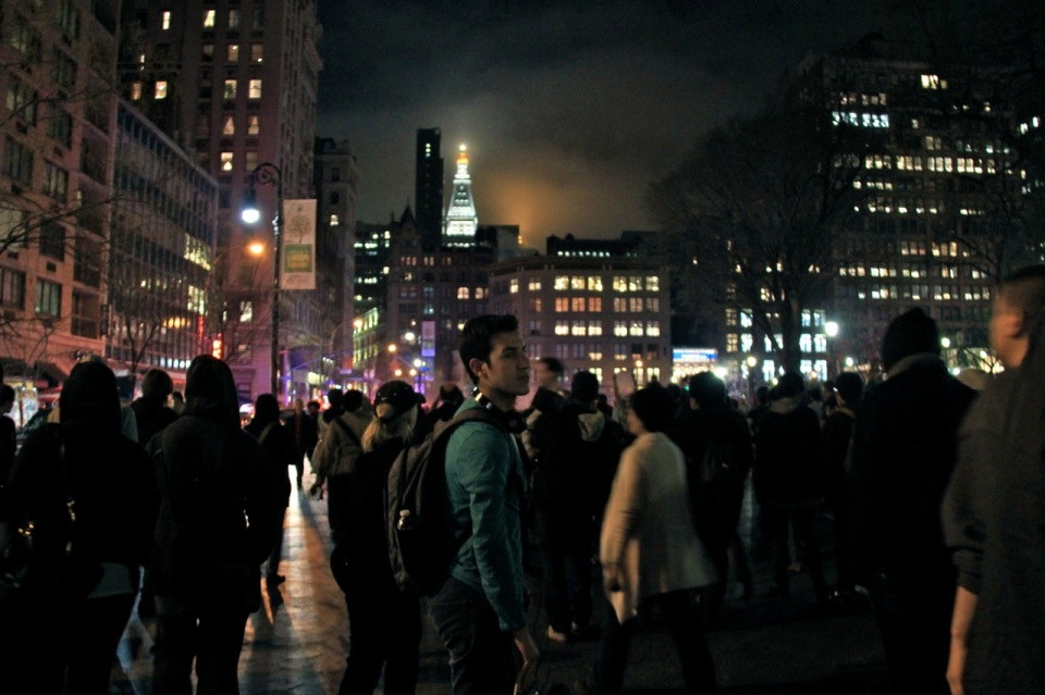 Union Square New York City crowds and night lights with cloud