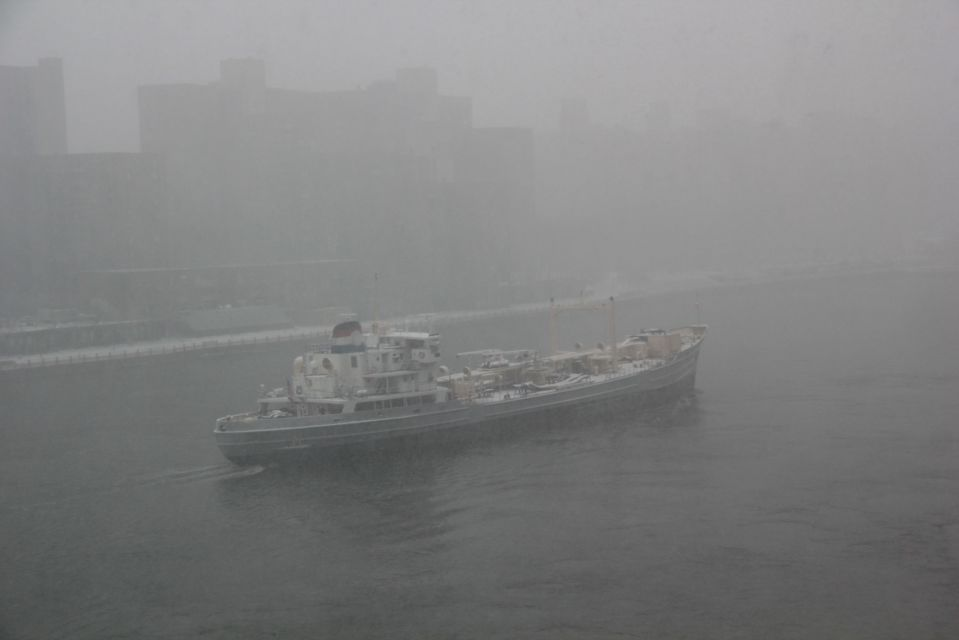 Ship in snow along East River NYC