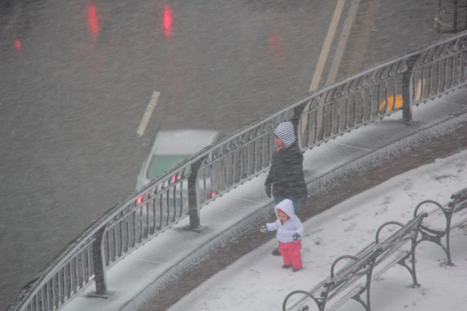 Adult and child in snow