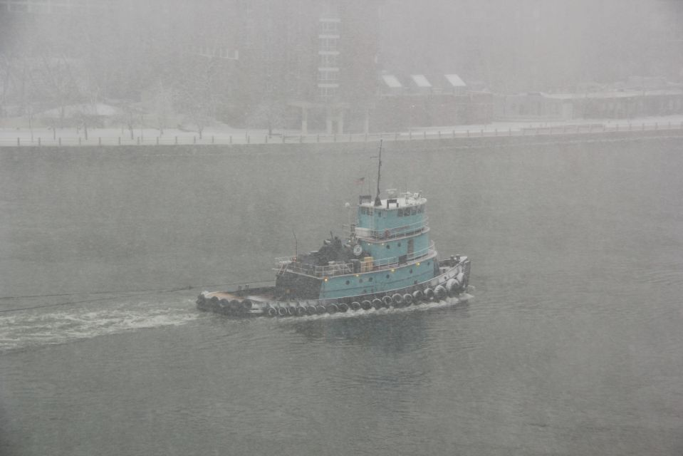 Tug Boat on East River New York in snow