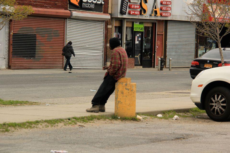 IMG_5137 Man smoking man walking near closed storefronts Rockaway.  PA*F