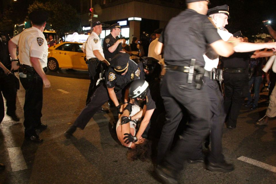 IMG_1604/Protestor held down on ground by NYPD