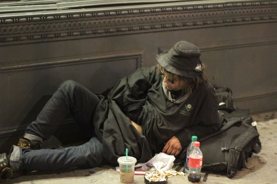 Young homeless man on new york street at night