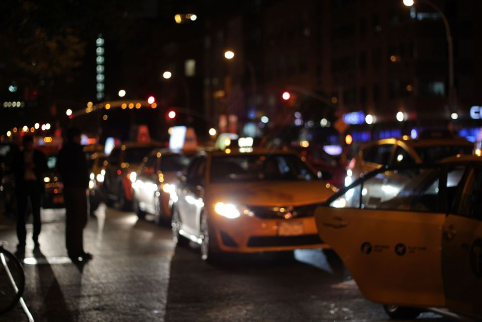 Yellow taxis in new york night lights