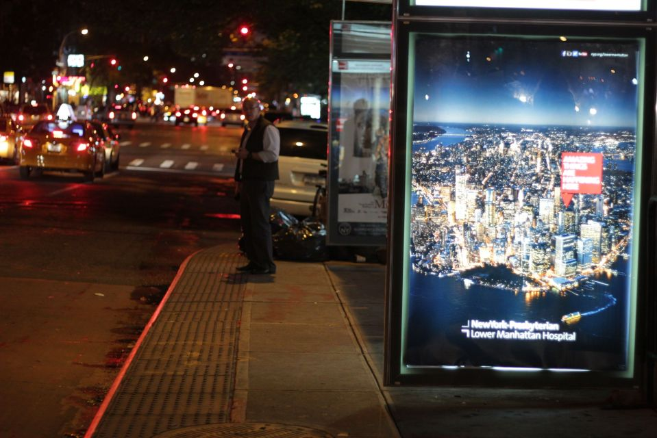 Waiting at Bus tsp in new york street at night