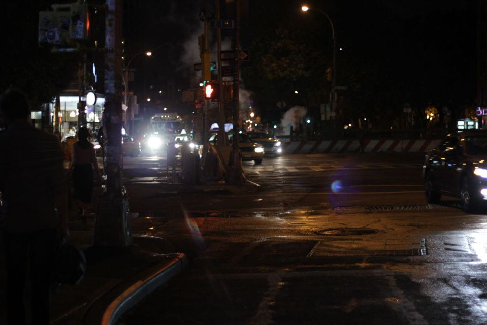 Steam and lights in new york street at night
