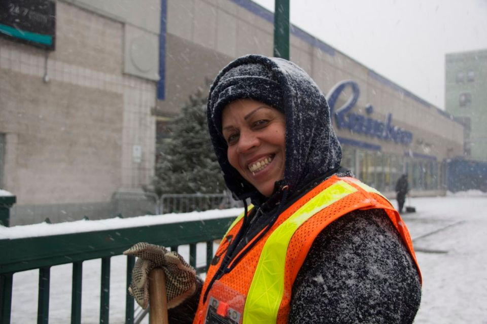 Smiling snow sweeper