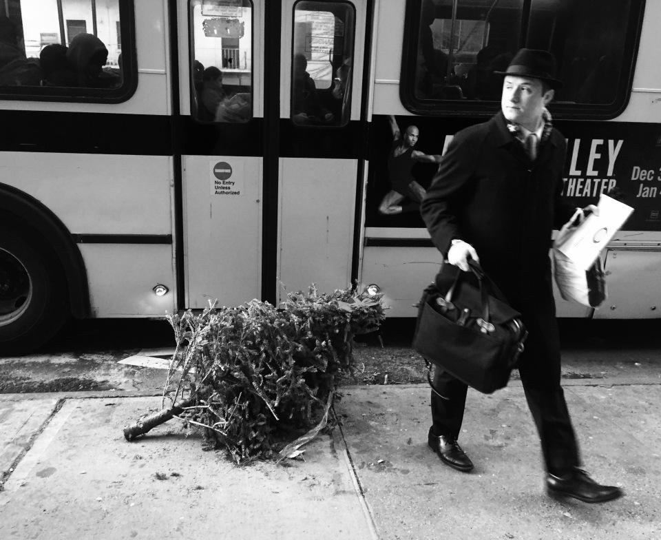 Man with bus and Christmas Tree