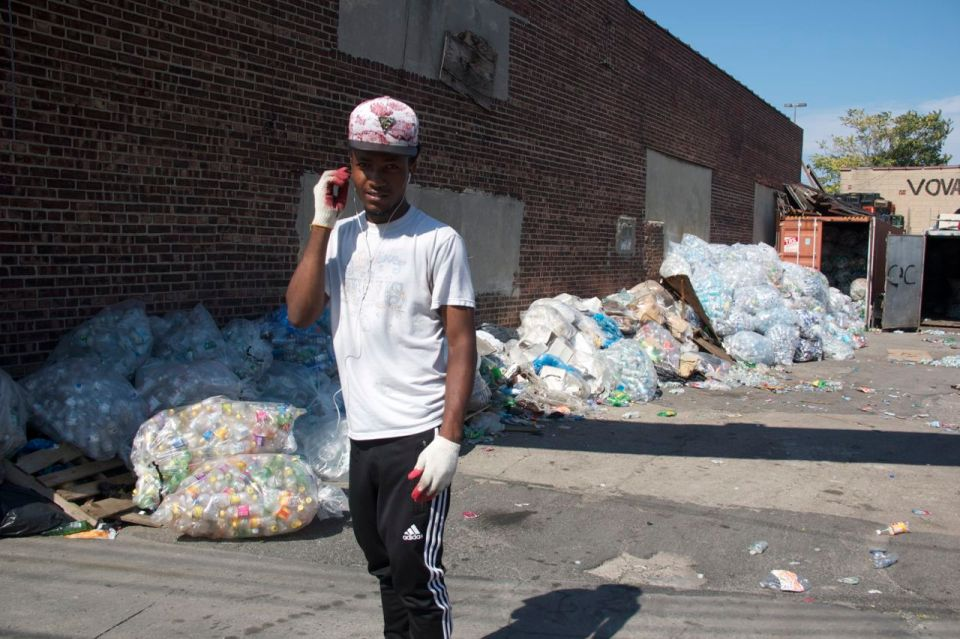 Young man bottle sorter in the Bronx, Hunts Point