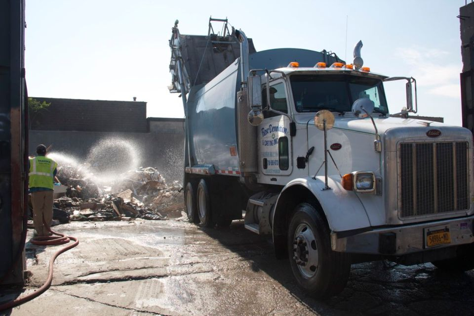 Hosing down builders rubble Hunts Point
