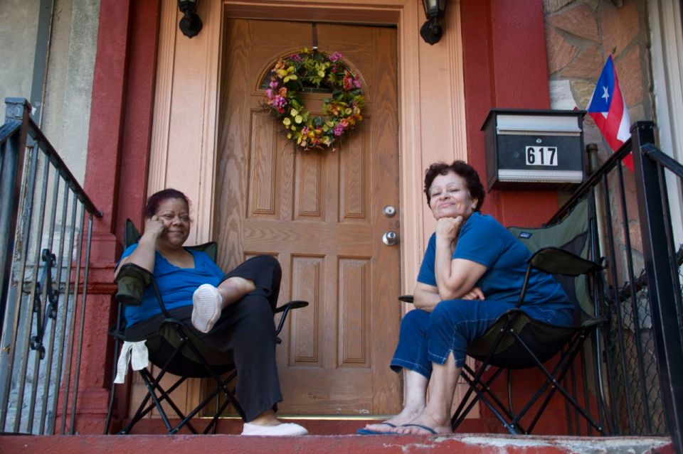 Patti and Martha sitting outside front of house
