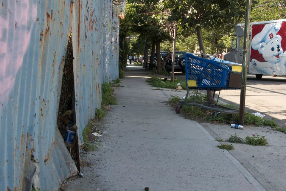 Street in Hunts point, blue coffee cup, blue shopping cart, blue spray can, teddy delivery van