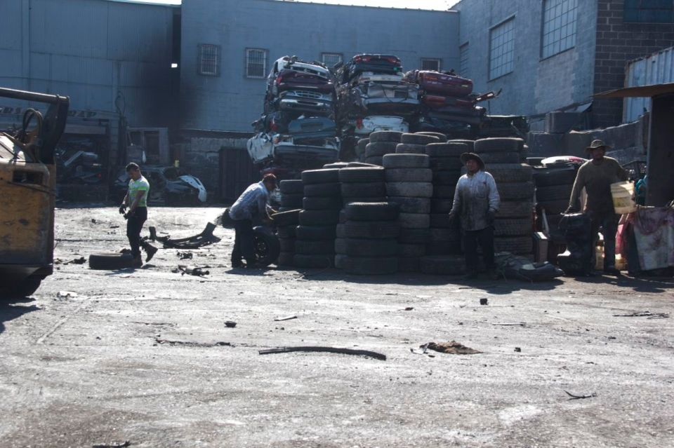 Men working in tyre yard, Hunts Point, the bronx