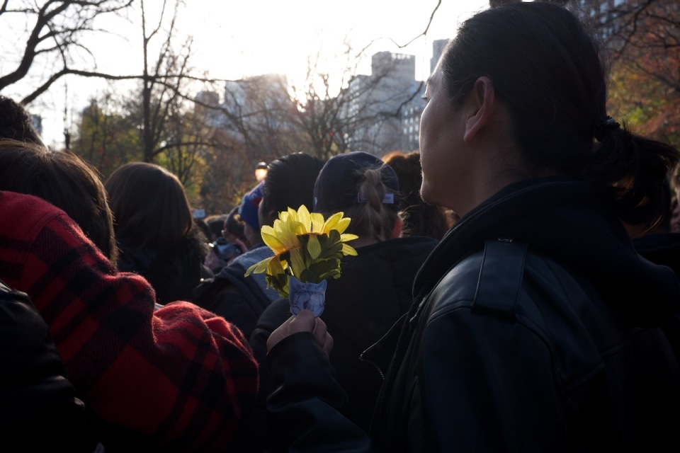 Fan at Strawberry Fields with small bouquet
