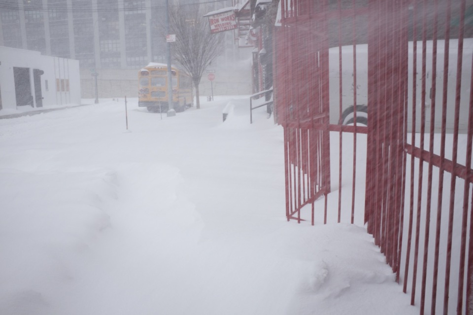 blinding snow and red rail fence, yello schhol bus