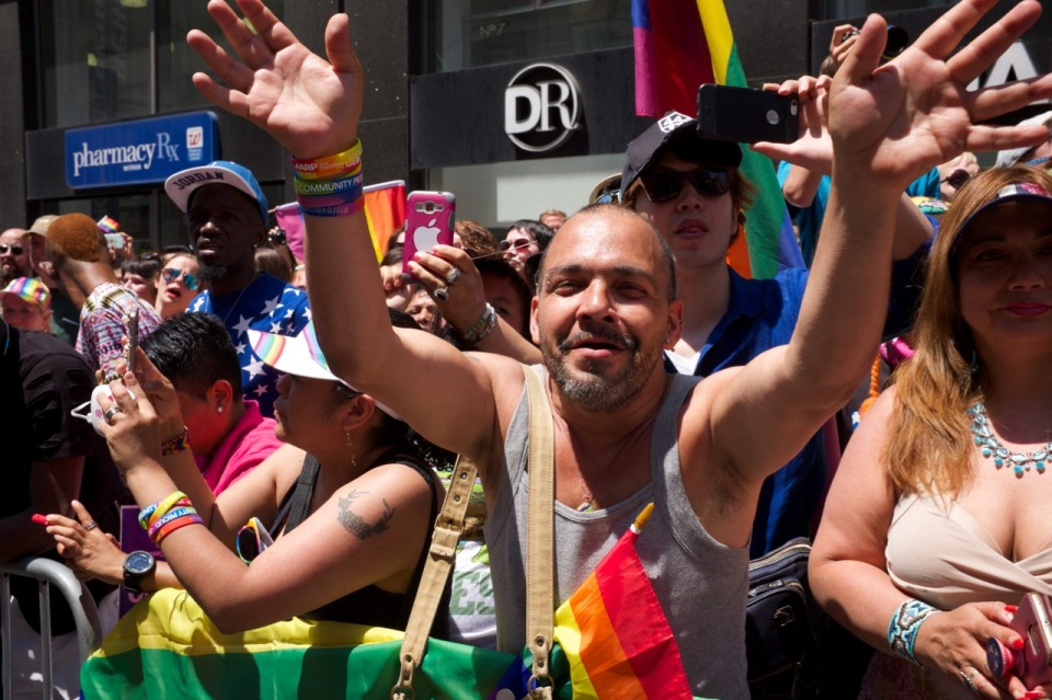 Man in crowd NYC Pride 2016