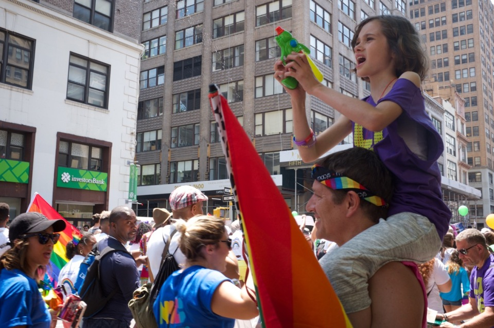 Girl with water gun NYC Pride 2016