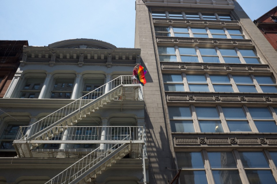 Rainbow flag from fire escape nyc pride 2016
