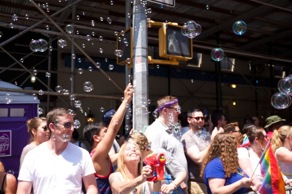 Women in nyc pride 2016 blowing bubbles