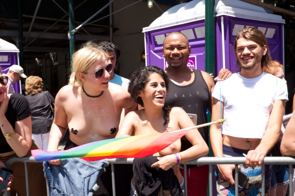 Bare chested women in niece pride 2016 crowd