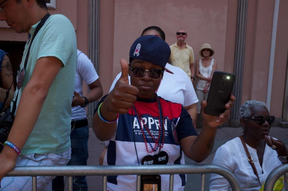 Woman thumbs up nays pride 2016 crowd