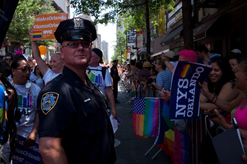 NYPD officer with crowd NYC pride 2016 Christopher St