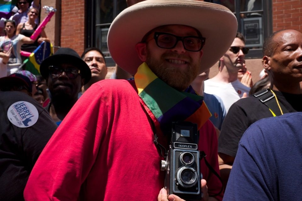 man in NYC pride 2016 crowd with Ikoflex camera