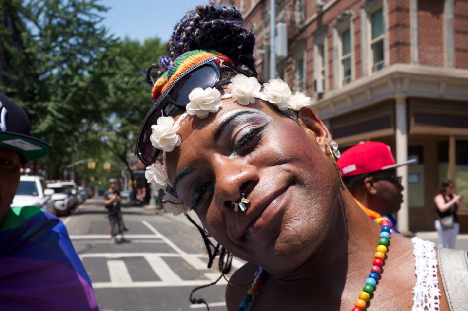 man NYC pride with flower head band