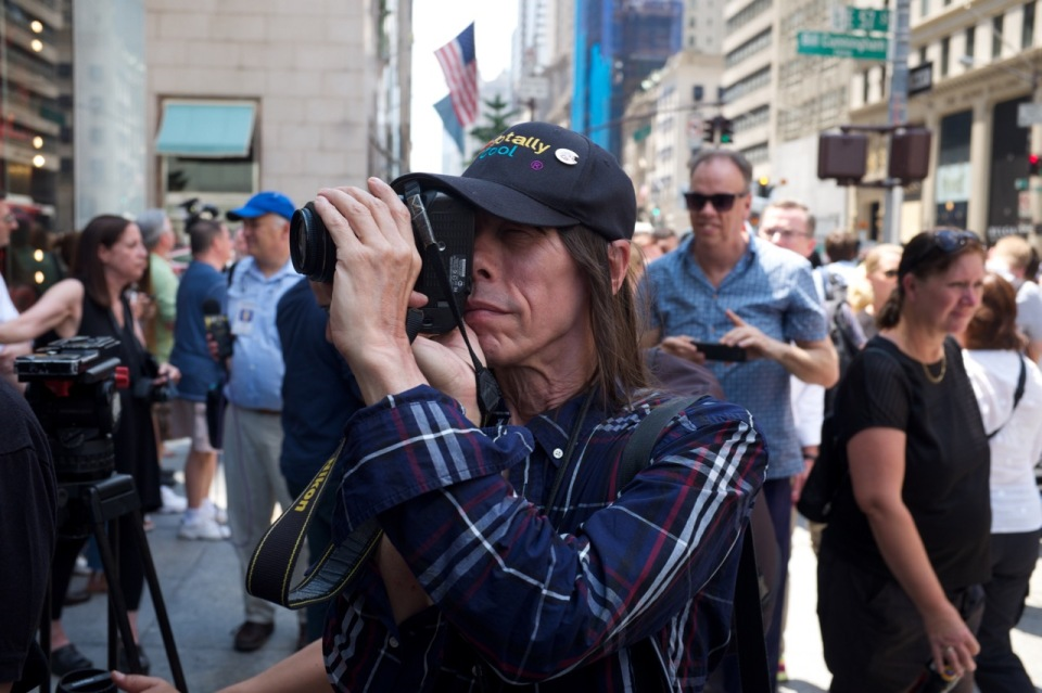 Photographer in new york city crowd