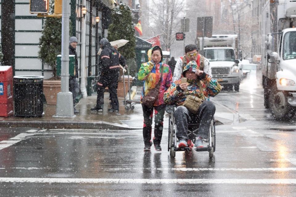 Wheelchair crossing road in snow